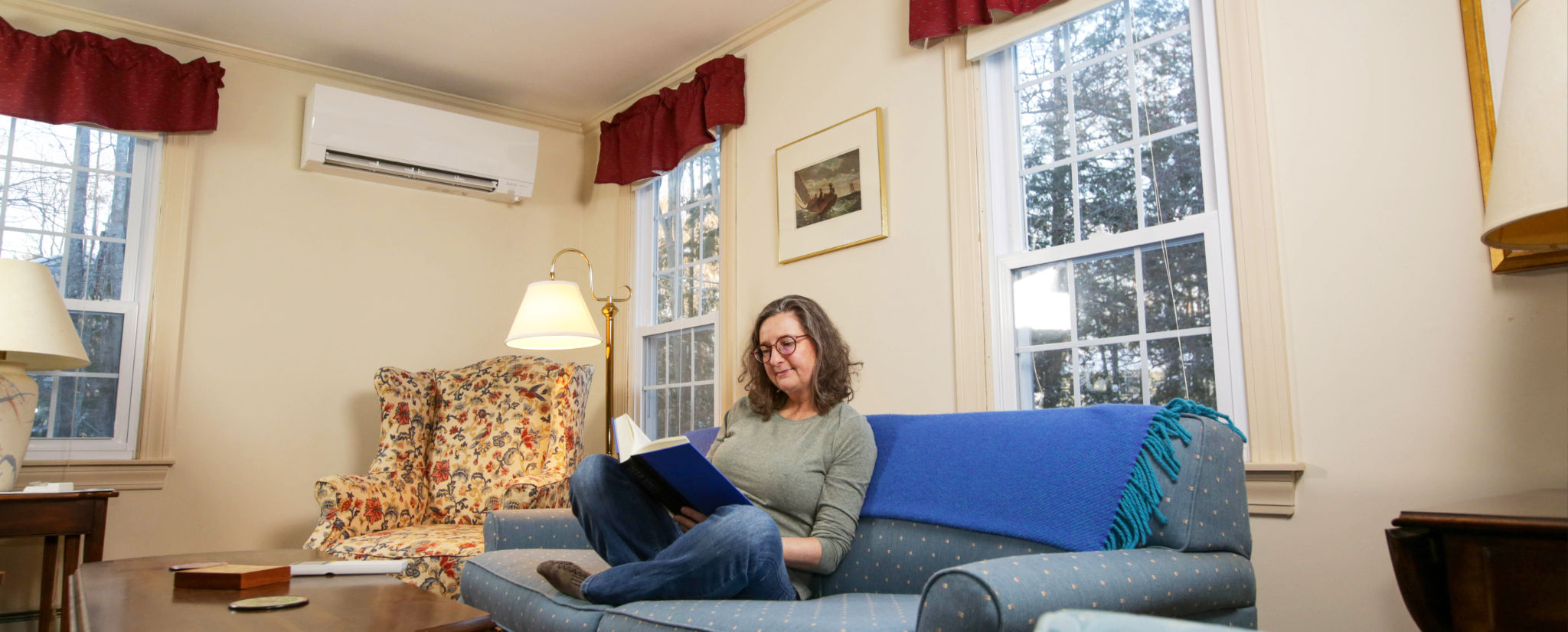 Woman reading in comforatble room with heat pump